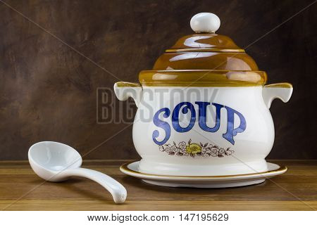 Soup tureen on wood table with ladle - Winter concepts
