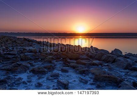 Colorful bright orange blue summer sunset over lake