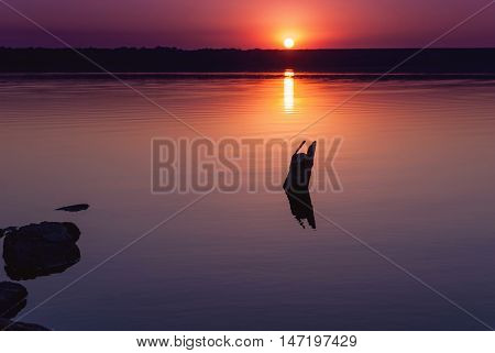 Colorful bright orange red summer sunset over lake