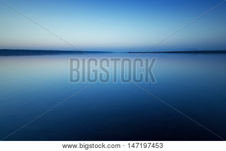Colorful bright blue summer sunset over lake