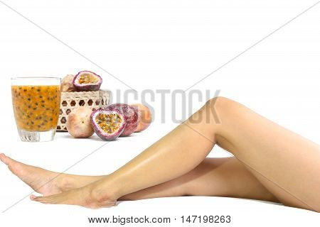 Health care passionfruits and woman leg isolated on white background