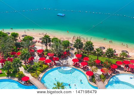 ABU DHABI, UAE - MARCH 30, 2014: Pool area of resort Khalidiya Palace by Rotana in Abu Dhabi, UAE. Rotana Hotel Management Corporation has 85 properties in 26 cities around Middle East and Africa.