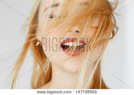 Enjoying something red-haired woman, close up. Portrait of carroty female adult with closed eyes. Seduction, satisfaction, orgasm, sexual arousal concept