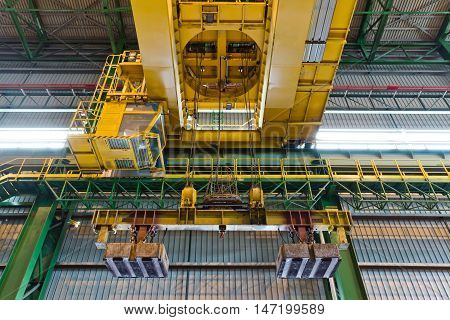 Crane with electrical magnet lift equipment at the metallurgical plant