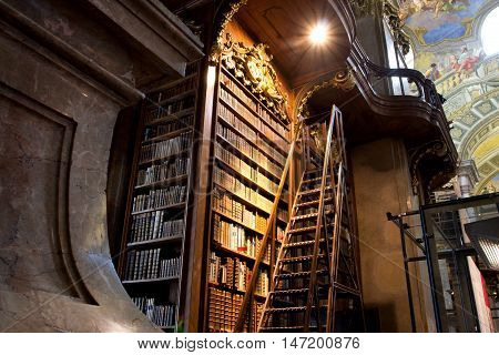 VIENNA, AUSTRIA - MAY 30, 2013: Stairs near the tall bookcase inside the great Austrian National Library on May 30, 2013 in Vienna. Est in 18th century the largest library in Austria with 7.4 mill items