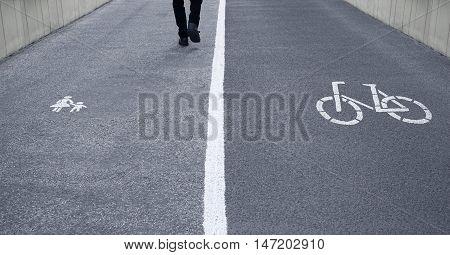 street divided in pedestrian footpath and bike lane