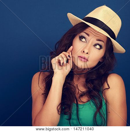 Fun Grimacing Frightened Woman In Hat Thinking With Asking Look. Curly Brown Long Hair Style. Toned