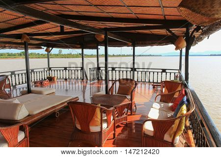 MEKONG, LAOS - MAY 2015 : Furniture of second deck of Vat Phou Cruise, a floating hotel, steel hulled teak barge, on Mekong River, Southern Laos on May 24, 2015.