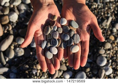 sea stones, stones in hands, small stones, beach stones