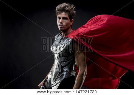 legionnaire, centurion or Roman warrior with iron armor, military helmet with horsehair and sword