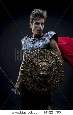 Pride, centurion or Roman warrior with iron armor, military helmet with horsehair and sword