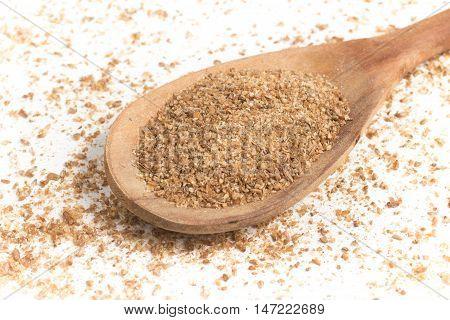 Ground Wheat into a spoon. Trigo para quibe. Kibbeh