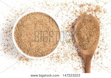 Ground Wheat into a bowl isolated in white background. Trigo para quibe. Kibbeh