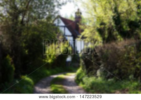 Country Cottage At The End Of A Rural Track Out Of Focus.