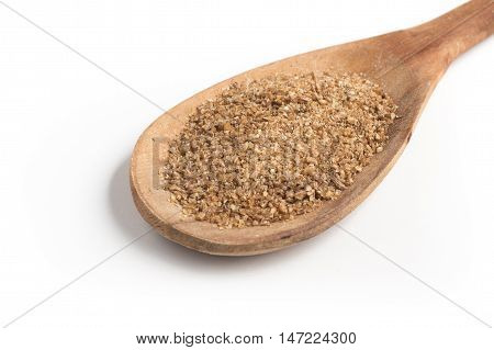 Ground Wheat into a spoon. Trigo para quibe. Kibbeh