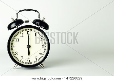 Alarm Clock isolated on white showing six o'clock.