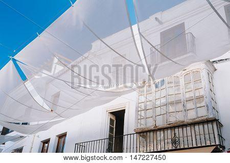 Old Architecture In Narrow Streets In Nerja, Spain. White Balcony