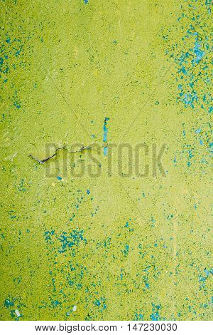 Close View Of Multilayer Dyed And Cracked Flaked Texture Of Blue And Light Green Paint At  The Surface.