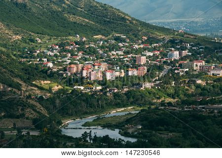 The Scenic View Of Mtskheta, Georgia. Uptown, The Residential Area On Green Hillside By The Mountain River In Summer Sunny Day.
