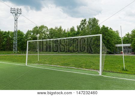White football goal on the forest background