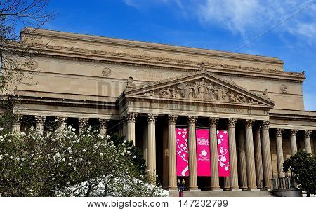 Washington DC - April 11 2014: The classical facade and ornate tympanum bas reliefs of the 1837 Archives of the United States building on Constitution Avenue *