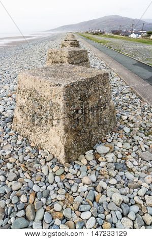 Anti-tank cubes from World War II to prevent invasion. Fairbourne beach North Wales United Kingdom Europe