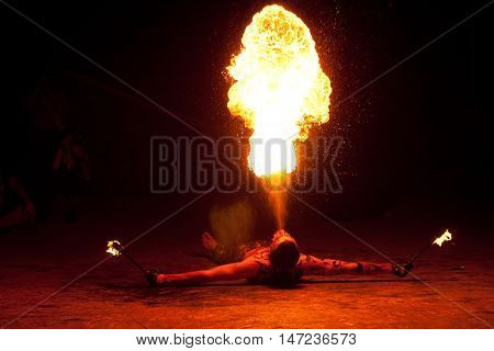 RUSSIA, BALTIYSK - JULY 06, 2014: The unknown artists demonstrate the fire show at the open festival BALTIC FIRE FEST - 2014 on july 06, 2014 in Baltiysk, Kaliningrad region.