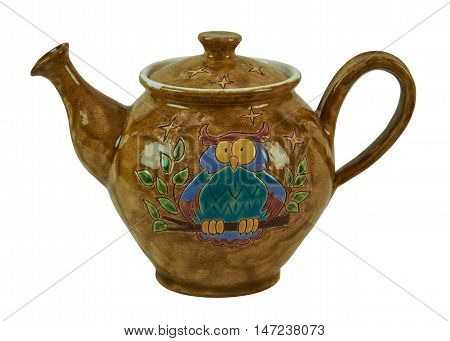 Colorful teapot - pottery handmade from clay glazed. Teapot decorated with patterned owls. Isolated on a white background