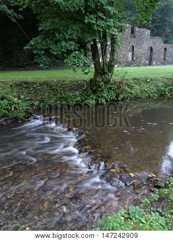Ironworks ruin and waterfall river photographed at Stepaside in Pembrokeshire