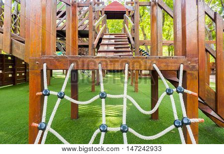 Wooden playground equipment without children in the park