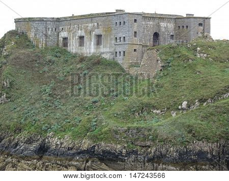 Castle upon cliff seascape photographed at Tenby in Pembrokeshire