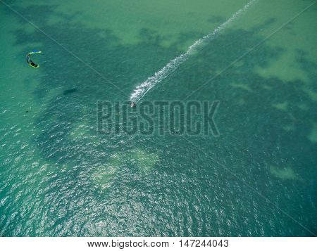 Aerial view of Kite surfing in the shallows of the island Koh Phangan Thailand