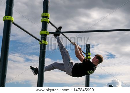 Moscow, Russia - September 10, 2016: Young man practices street workout on open competition dedicated to City Day