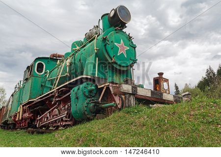 Old Soviet locomotive stands on a dead-end path. Transport