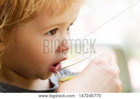 Cute Baby Boy Drinks Juice