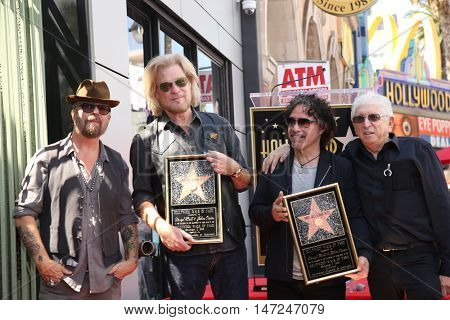 LOS ANGELES - SEP 2:  Dave Stewart, Daryl Hall, John Oates, Jerry Greenberg at the Hall & Oates Hollywood Walk of Fame Star Ceremony on Hollywood Boulevard on September 2, 2016 in Los Angeles, CA