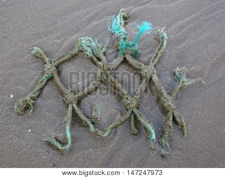 Fishing net upon beach seascape photographed at Wisemans Bridge in Pembrokeshire