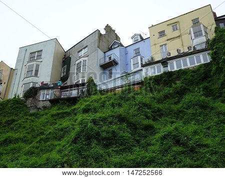 Houses upon cliffs photographed at Tenby in Pembrokeshire