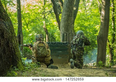 Two Soldiers Shooting In Forest
