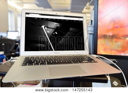 NEW YORK, NY - SEPTEMBER 7th, 2016: Apple website on MacBook Air showing launch announcement for new iPhone 7 with wireless AirPods
