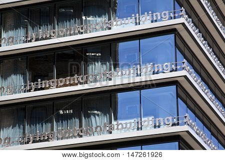 Vancouver, BC - April 20, 2015 - Apartment complex with the metal balcony made in letters that say