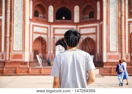 Young Traveler Walking Towards Entrance To Taj Mahal In Agra, India.