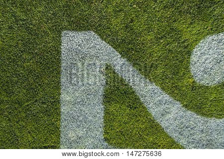 Extreme close up view of the numbers on a football field