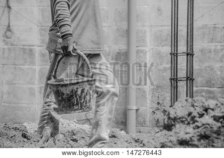 workman is working for construction black and white tone