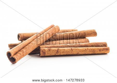 Cinnamon sticks isolated on white background.