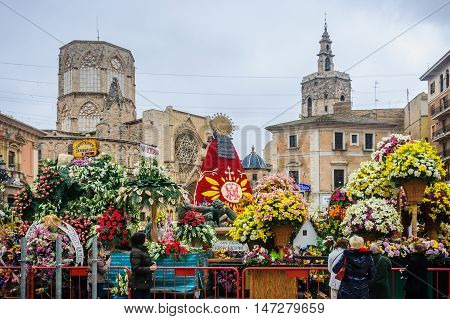 VALENCIA, SPAIN - MARCH 19, 2015: Plaza de la Virgen with flowers during Las Fallas Festival in the city of Valencia Spain