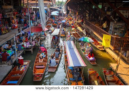 Ratchaburi Thailand- March 20 2016 : Damnoen Saduak Floating Market tourists visiting by boat located in Ratchaburi Thailand.