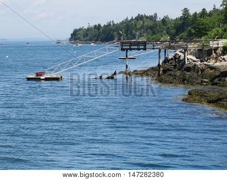 Boats in slip and cove at the Casco Bay Region of Maine