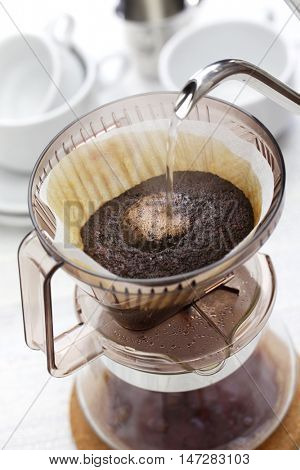 making hand drip coffee by paper filter