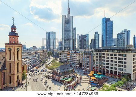 Frankfurt, Germany - September 10, 2016: tourists enjoing Hauptwache square on sunny day